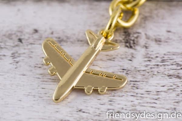 Schlüsselanhänger Flieger goldfarben