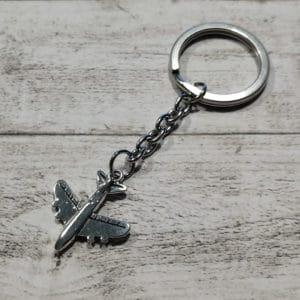Schlüsselanhänger Flieger silberfarben